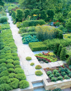 A long view of the central axis reveals the level changes and carefully chosen plants that define each garden area